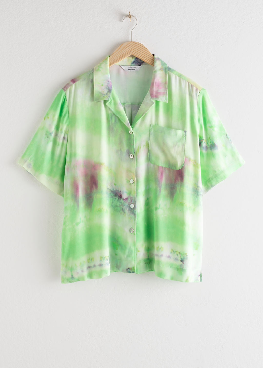 Front image of Stories tie dye button up shirt in green
