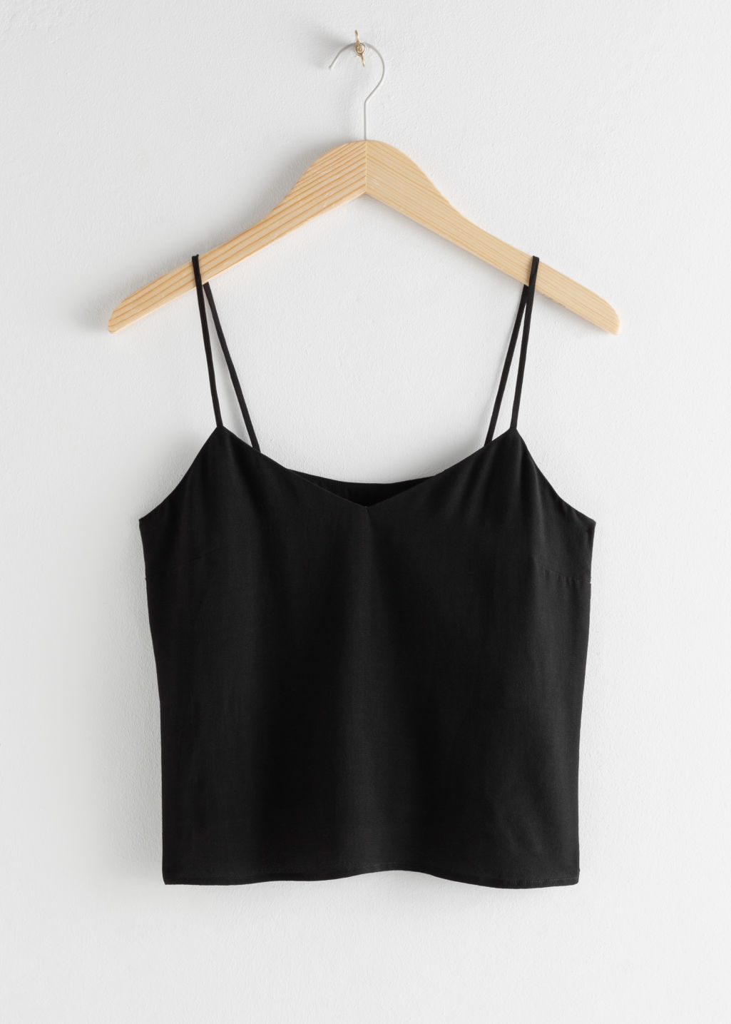 Front image of Stories spaghetti strap tank top in black