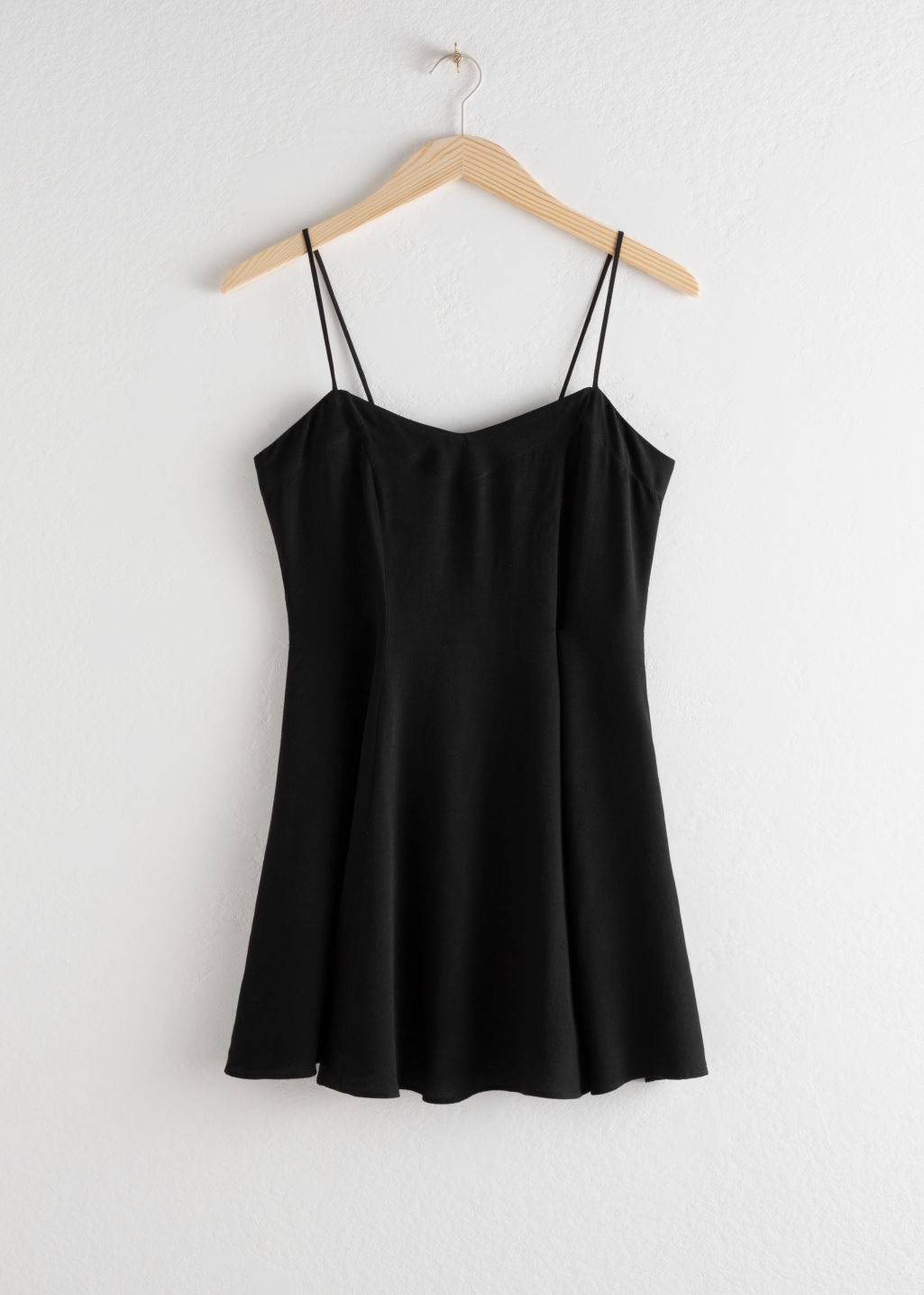 Front image of Stories spaghetti strap mini skater dress in black