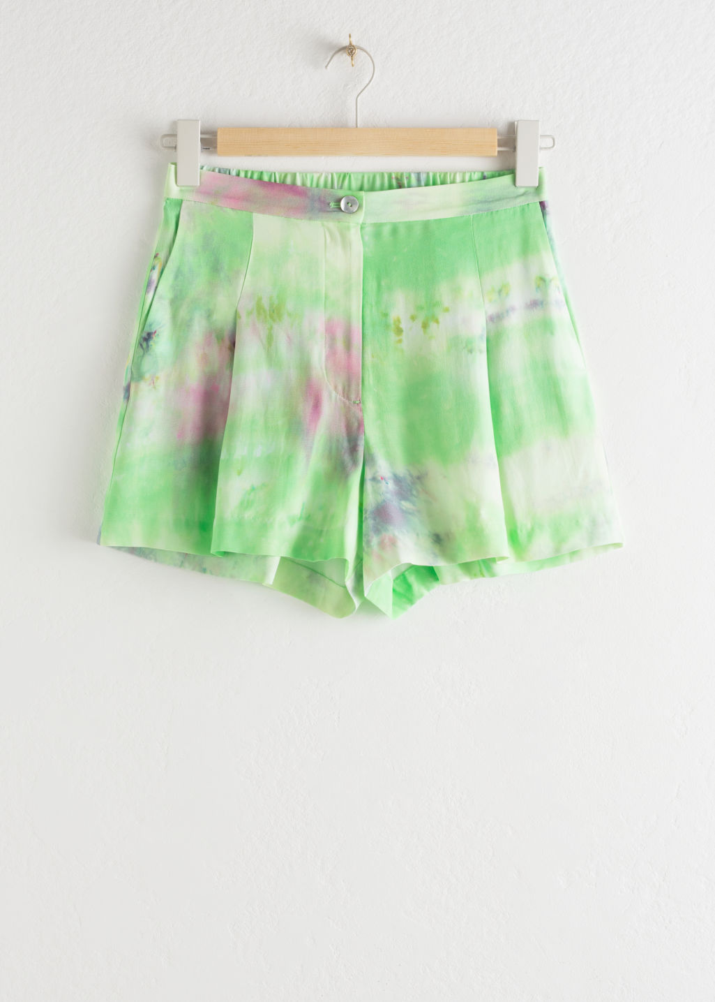 Front image of Stories tie dye shorts in green