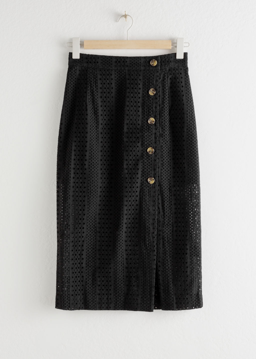 Front image of Stories cotton dobby pencil midi skirt in black