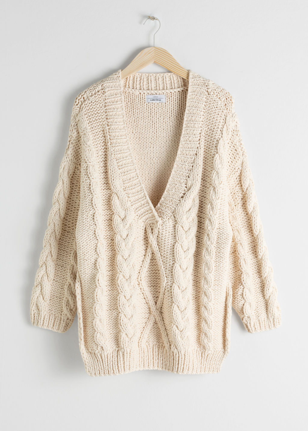 Front image of Stories organic cotton cable knit sweater in white