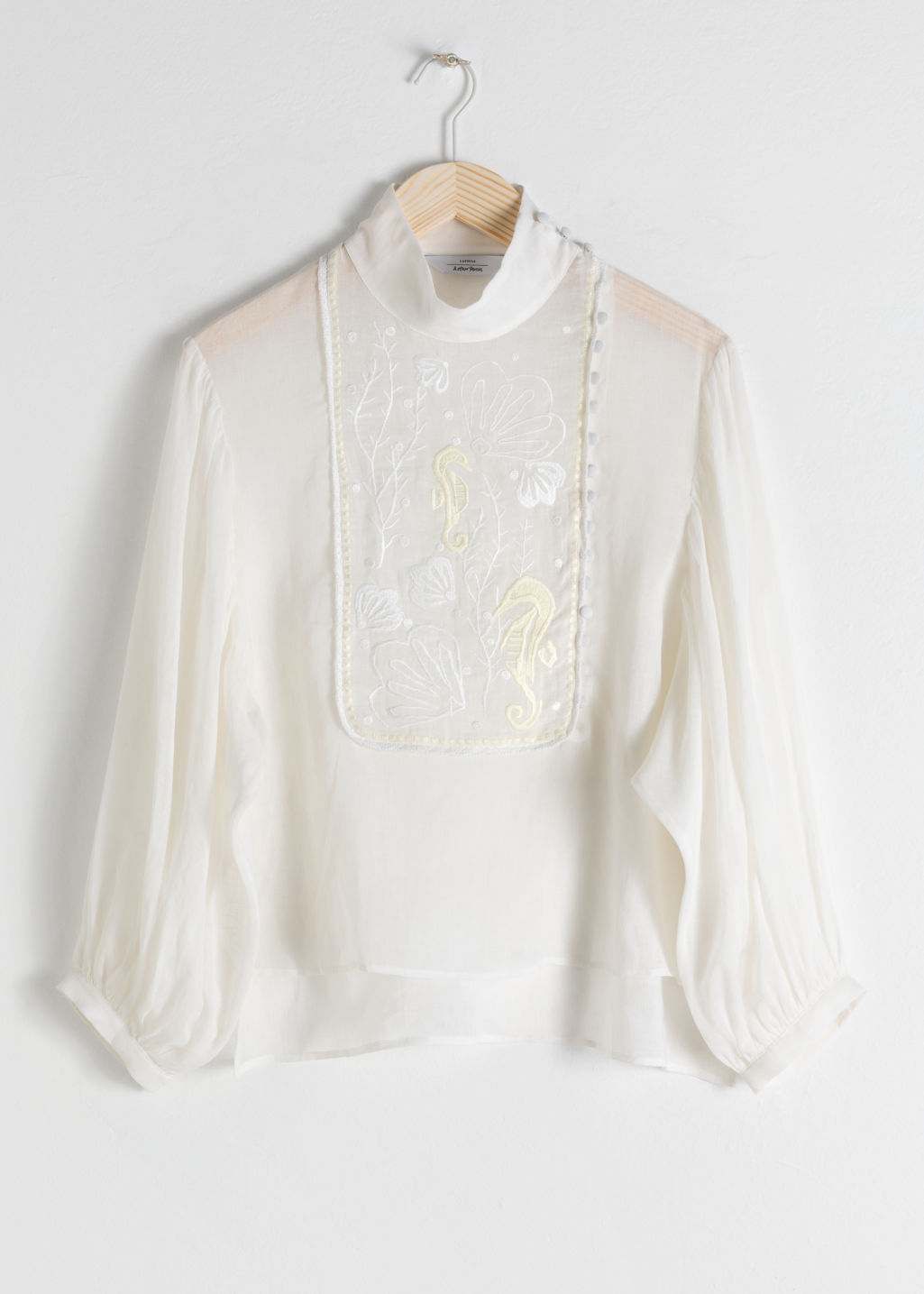 Front image of Stories sheer embroidered linen blend blouse in white