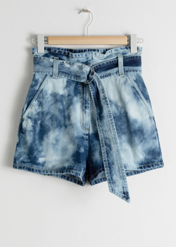 Front image of Stories tie dye organic cotton denim shorts in blue
