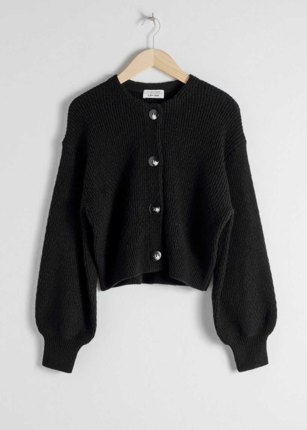 Front image of Stories high neck cotton blend cardigan  in black