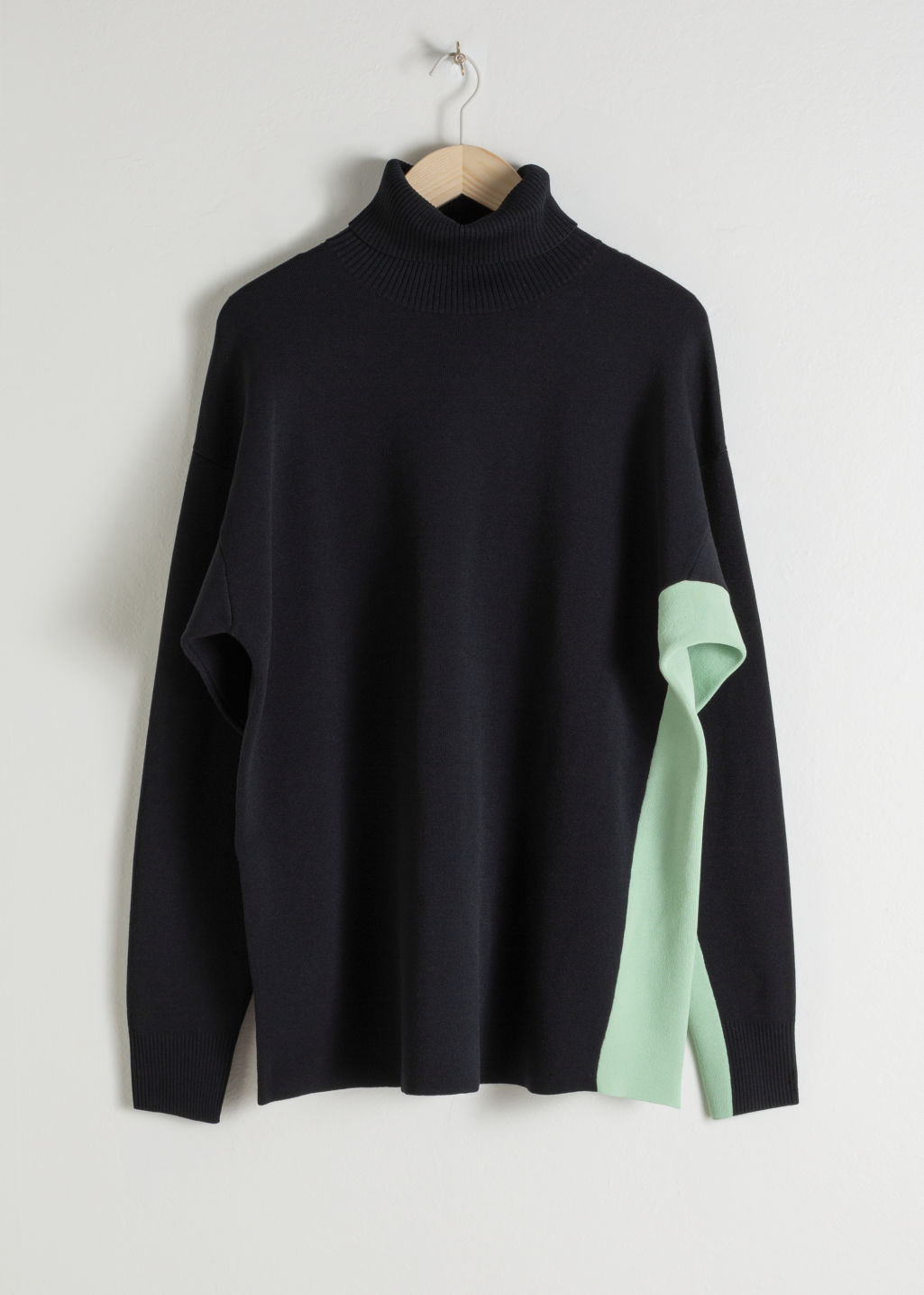 Front image of Stories oversized side stripe turtleneck in black