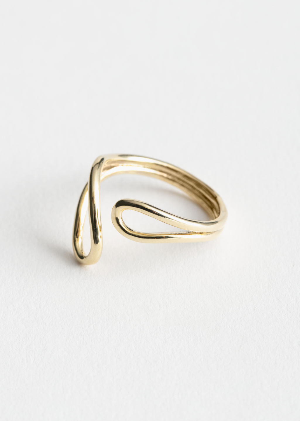 Front image of Stories droplet wrap ring in gold