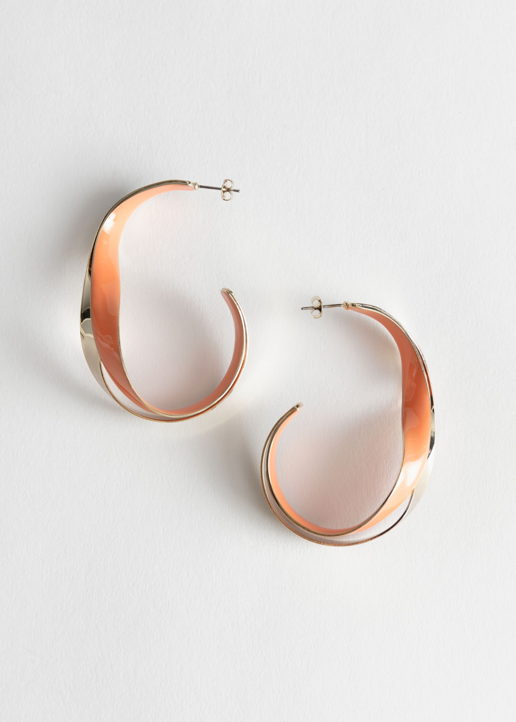 StillLife Front Image of Stories Duo Coloured Open Hoop Earrings in Orange