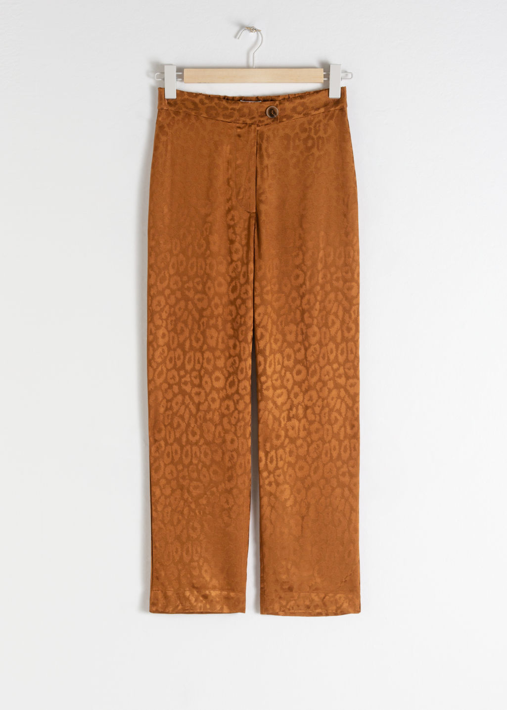 Front image of Stories leopard jacquard trousers in beige