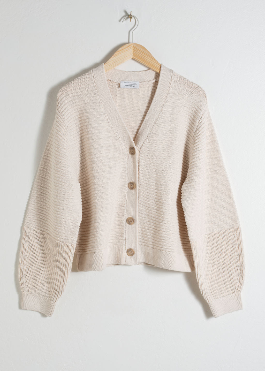 Front image of Stories cropped cotton cardigan in white