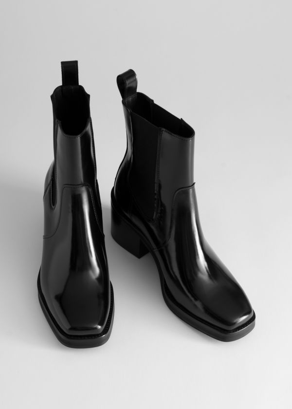 Front image of Stories square toe leather boots in black