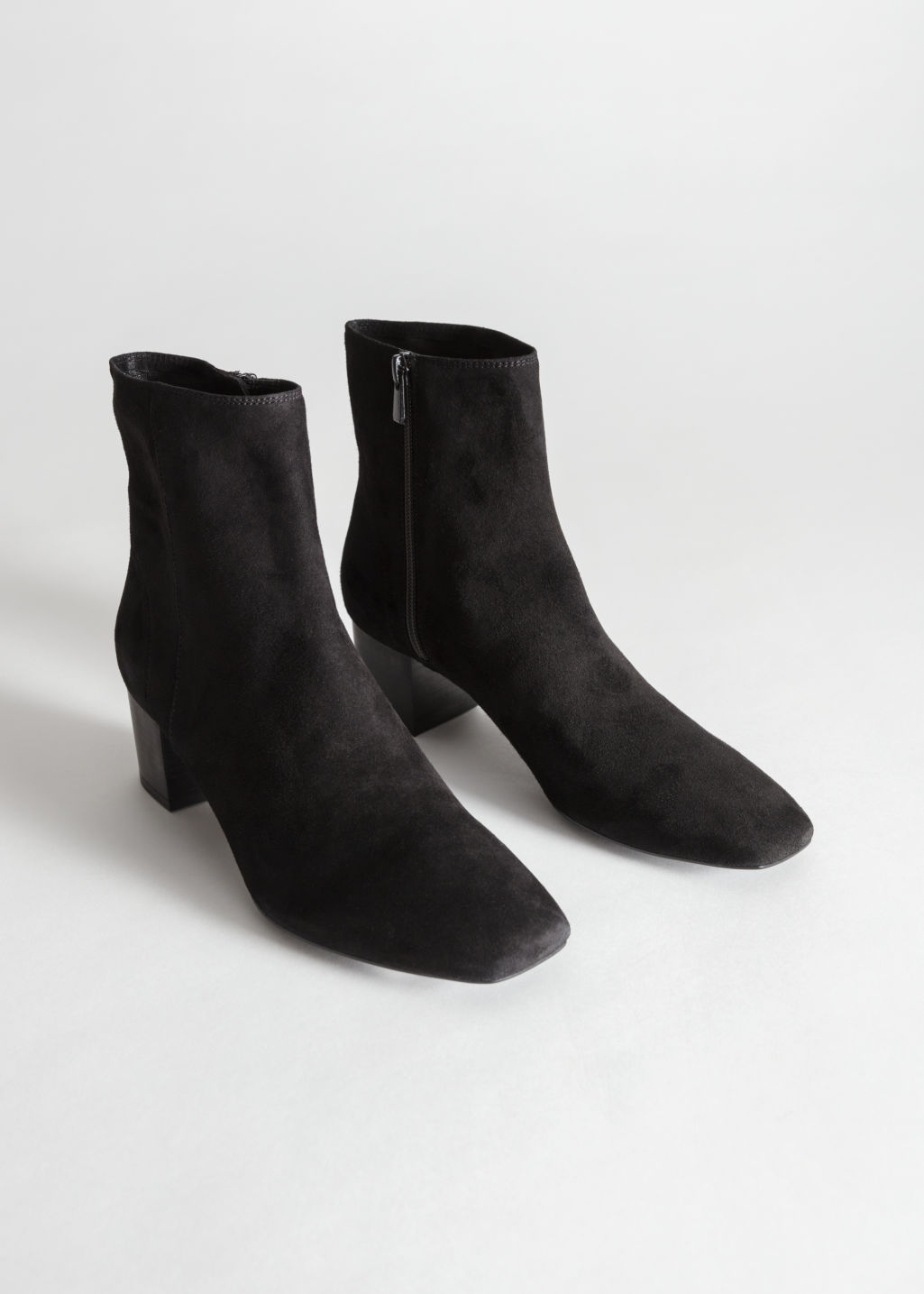 Front image of Stories suede ankle boots in black