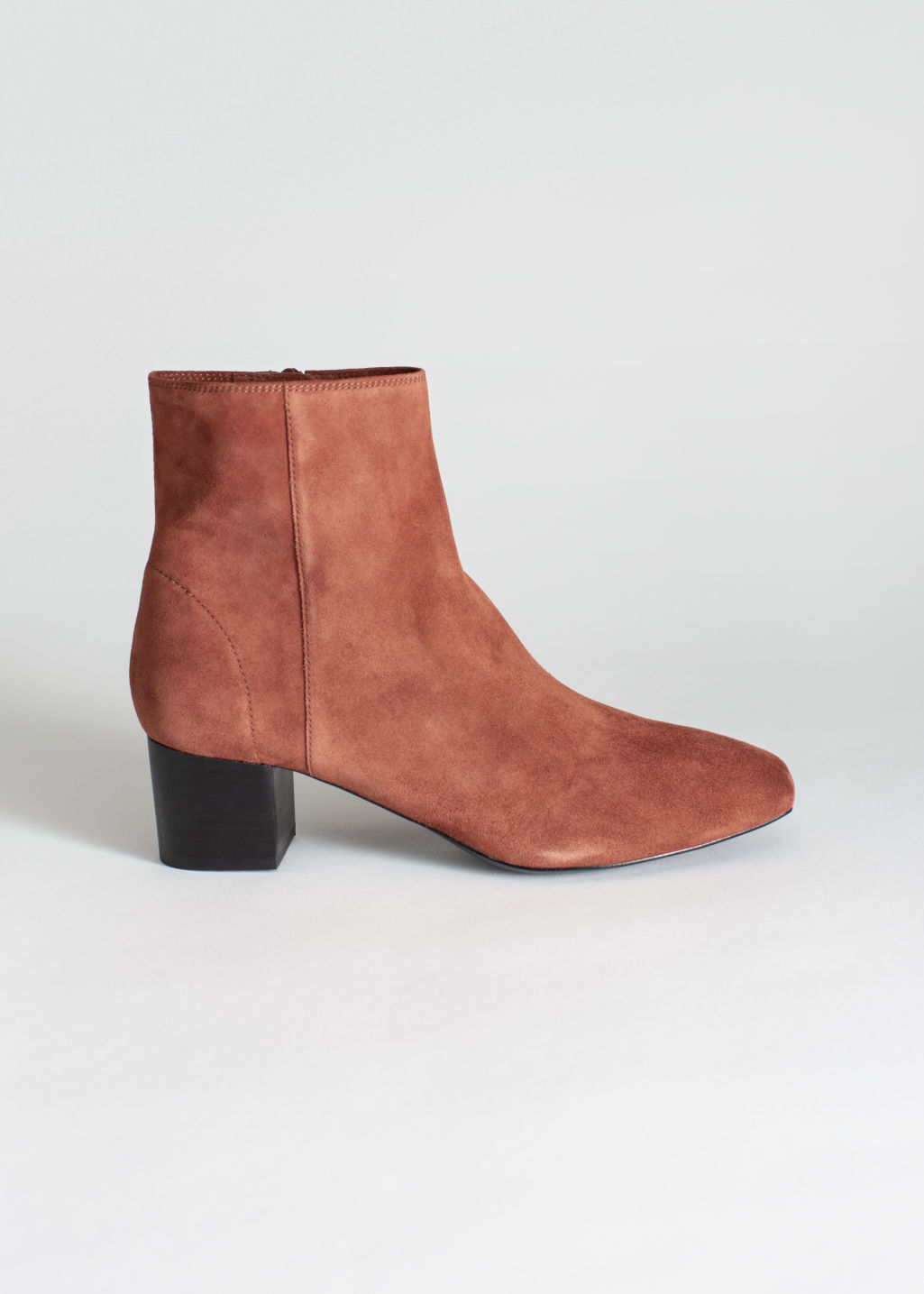 Front image of Stories suede ankle boots in orange