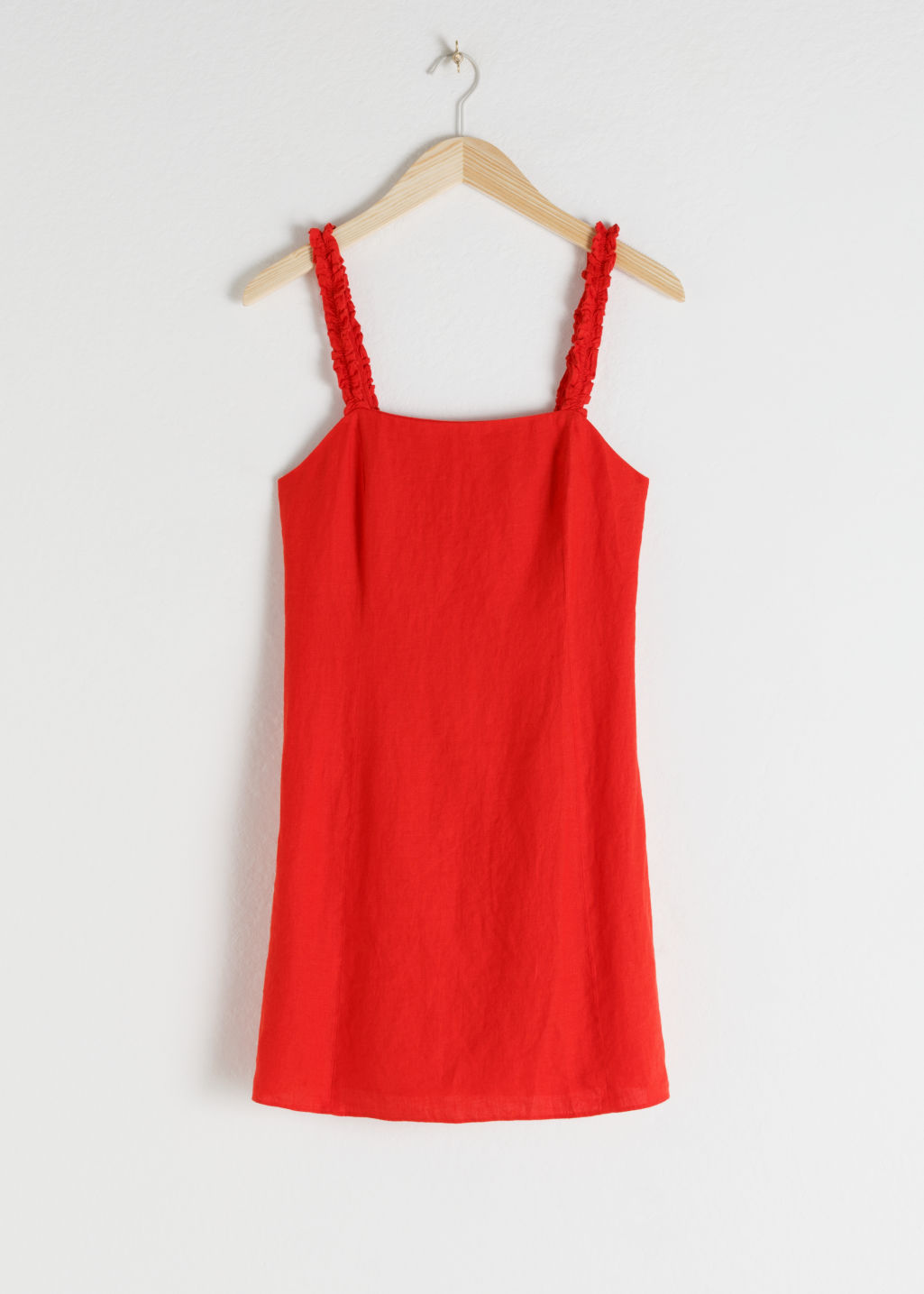 Front image of Stories ruffle strap linen mini dress in red