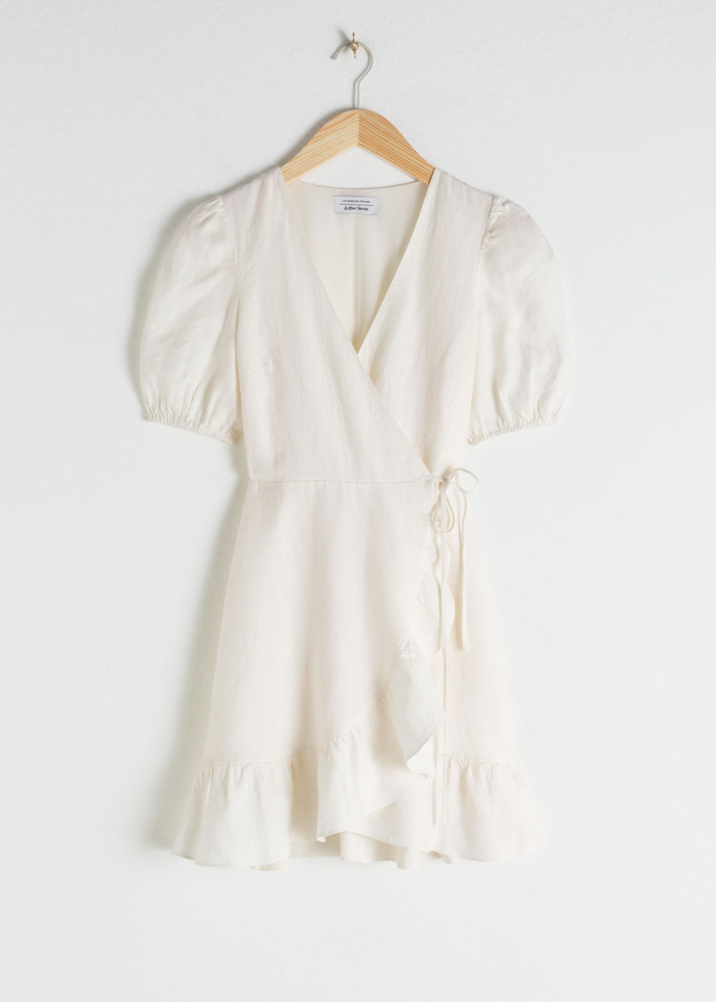 Front image of Stories puff sleeve linen wrap mini dress in white