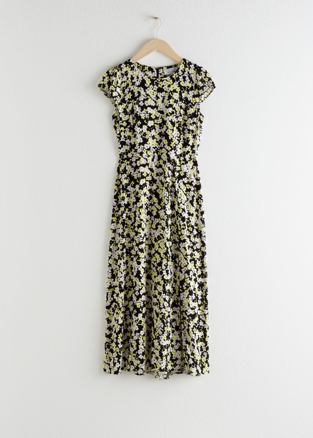 Front image of Stories polka dot midi dress in black