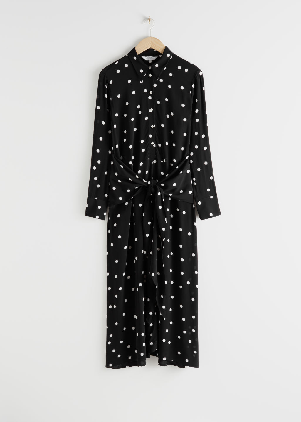Front image of Stories polka dot waist tie midi dress in black