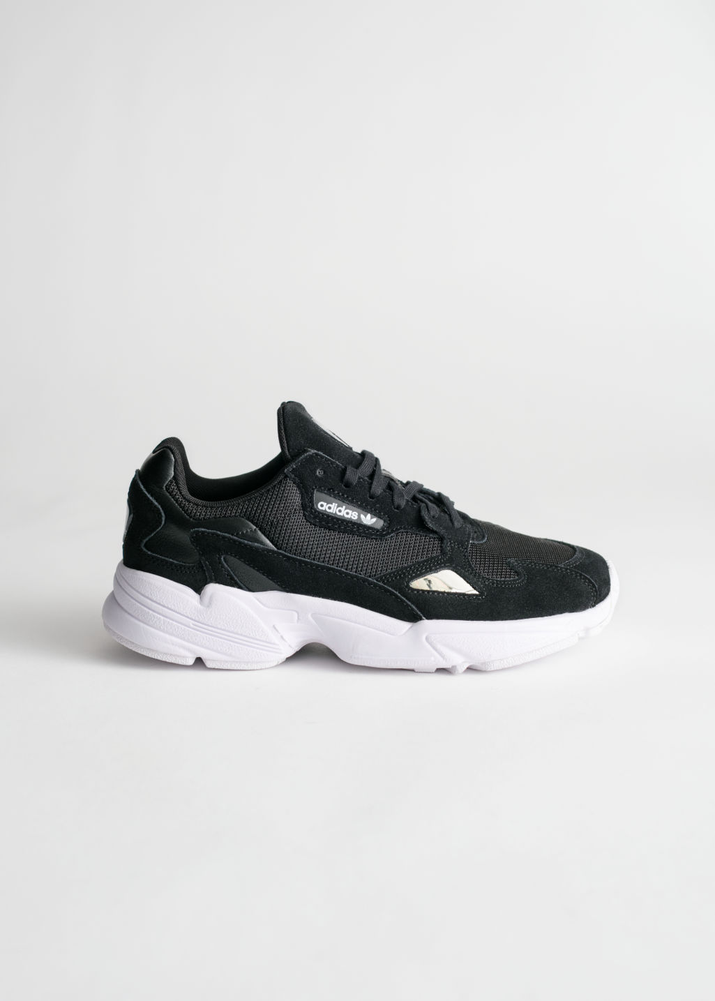 702b063579d7 Front image of Stories adidas falcon in black ...