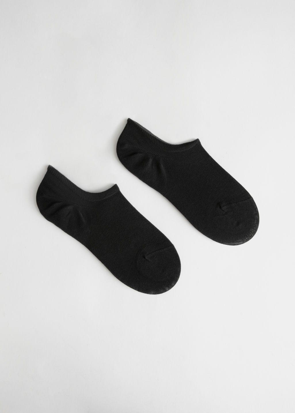 Front image of Stories two pack sneaker socks in black