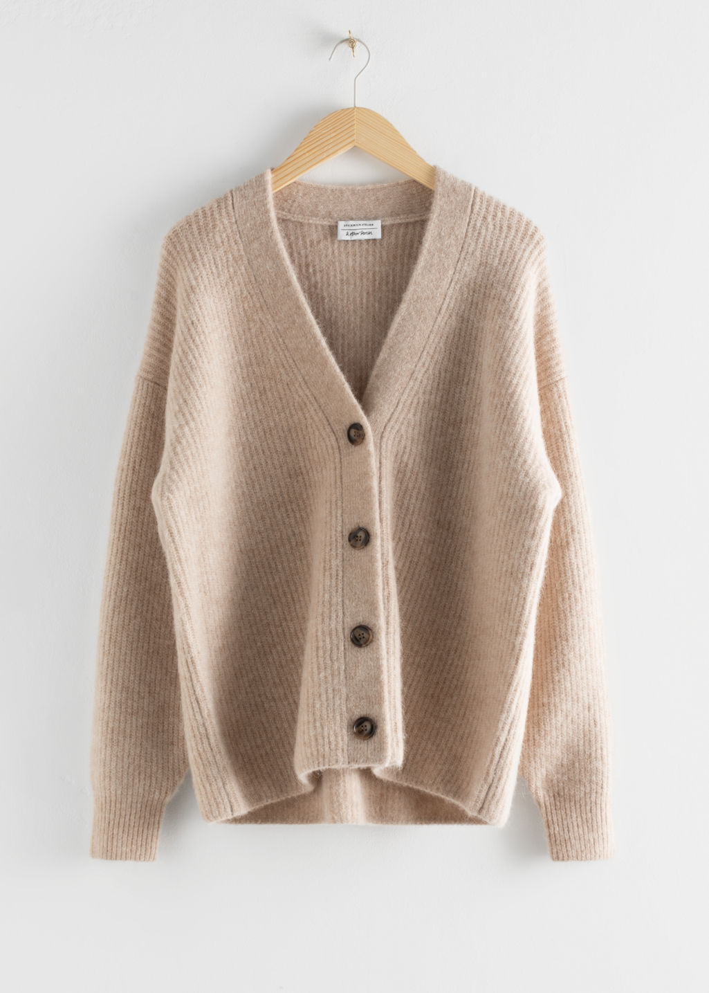 Front image of Stories oversized alpaca blend cardigan in beige