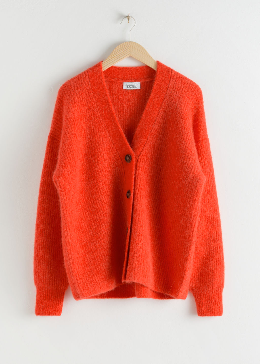 Front image of Stories oversized alpaca blend cardigan in orange