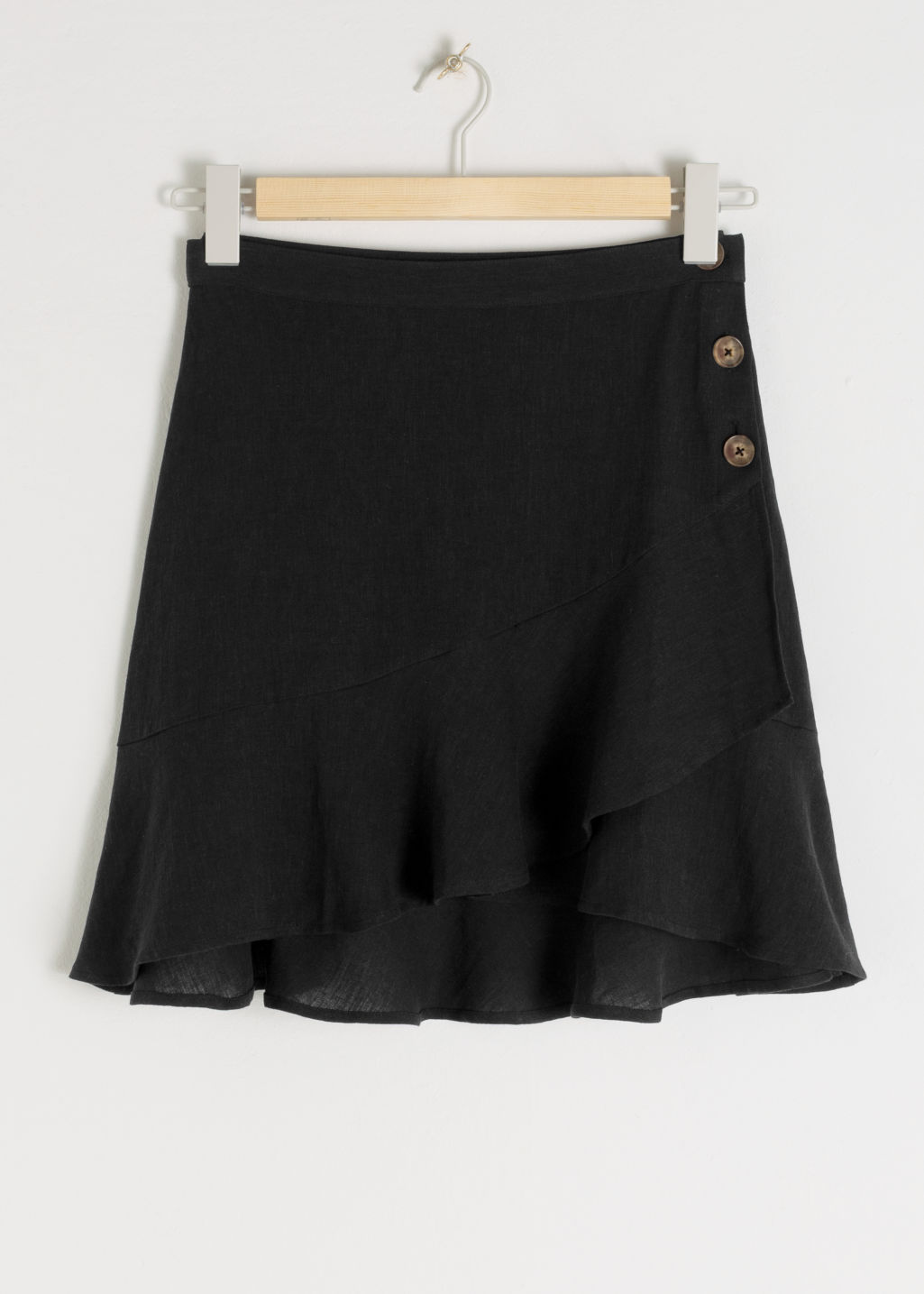 Front image of Stories ruffled linen blend mini skirt in black