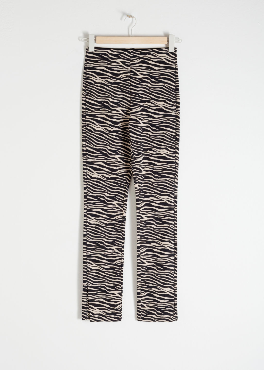 Front image of Stories zebra print legging trousers in beige
