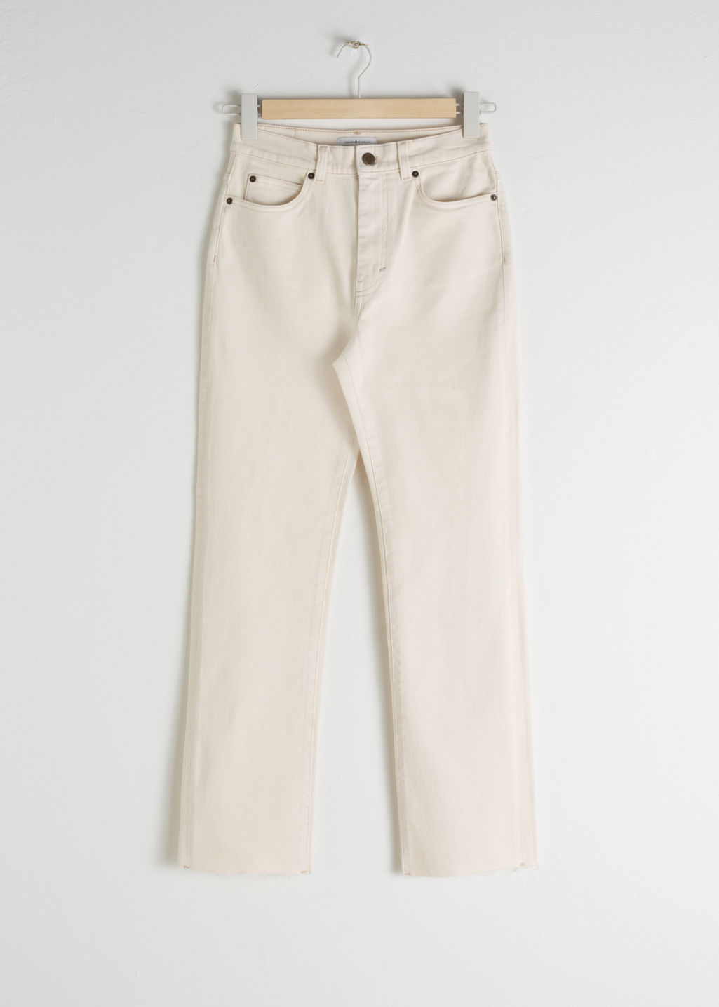 Front image of Stories tapered high rise jeans in white