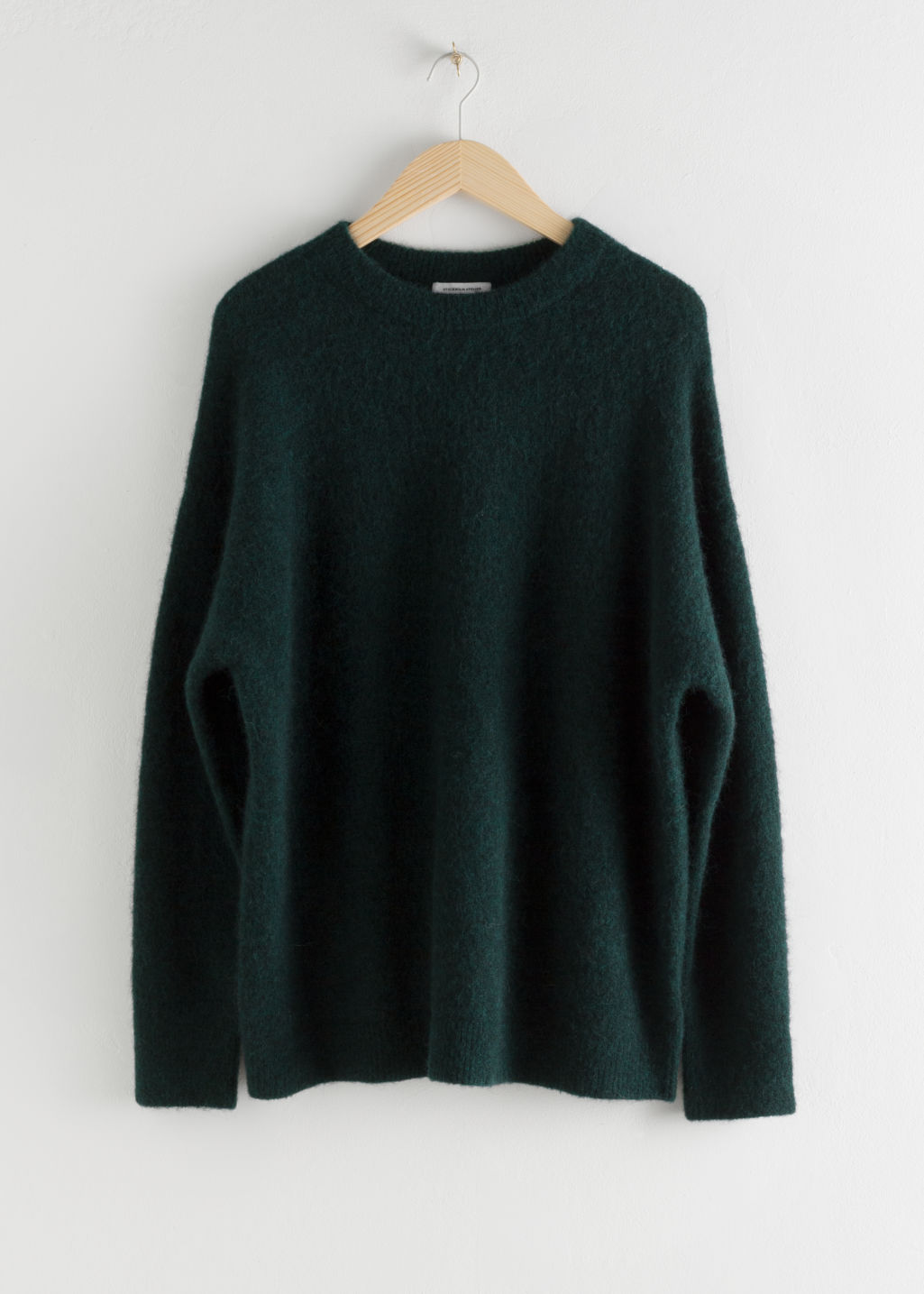 Front image of Stories alpaca blend relaxed sweater in green