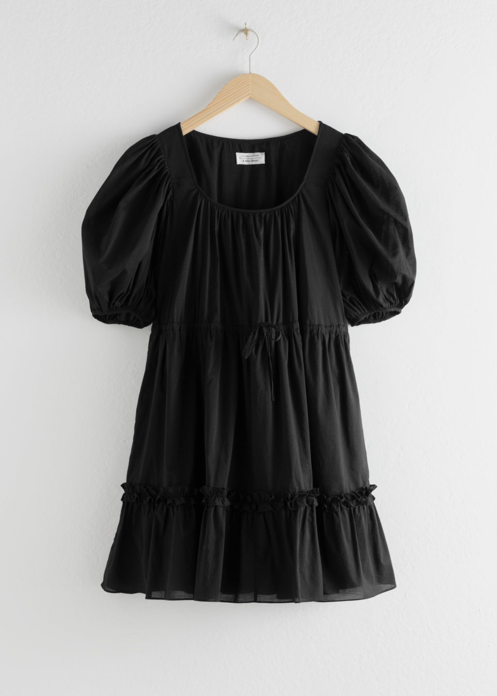 Front image of Stories cotton puff sleeve mini dress in black