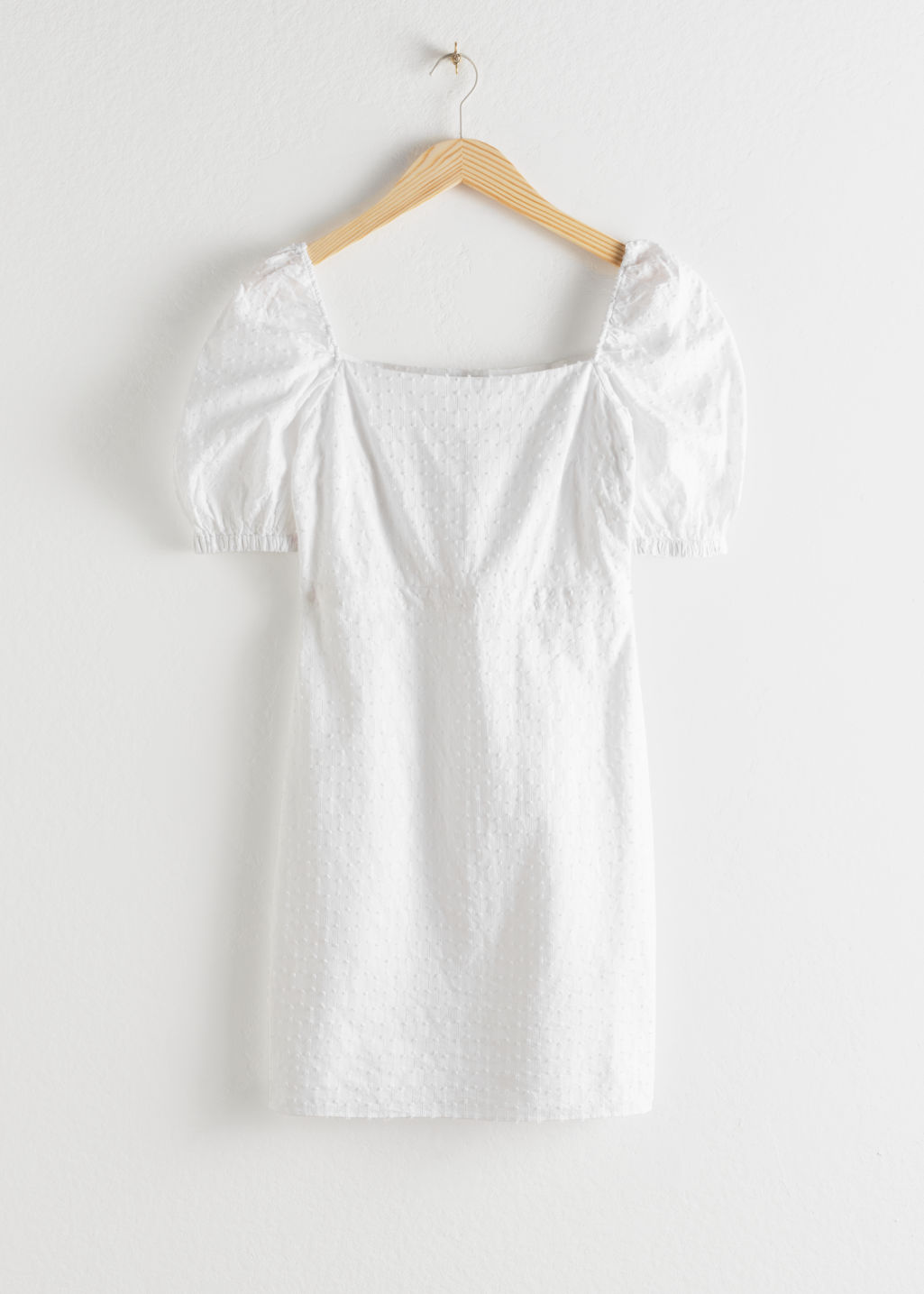 Front image of Stories puff sleeve dobby cotton mini dress in white