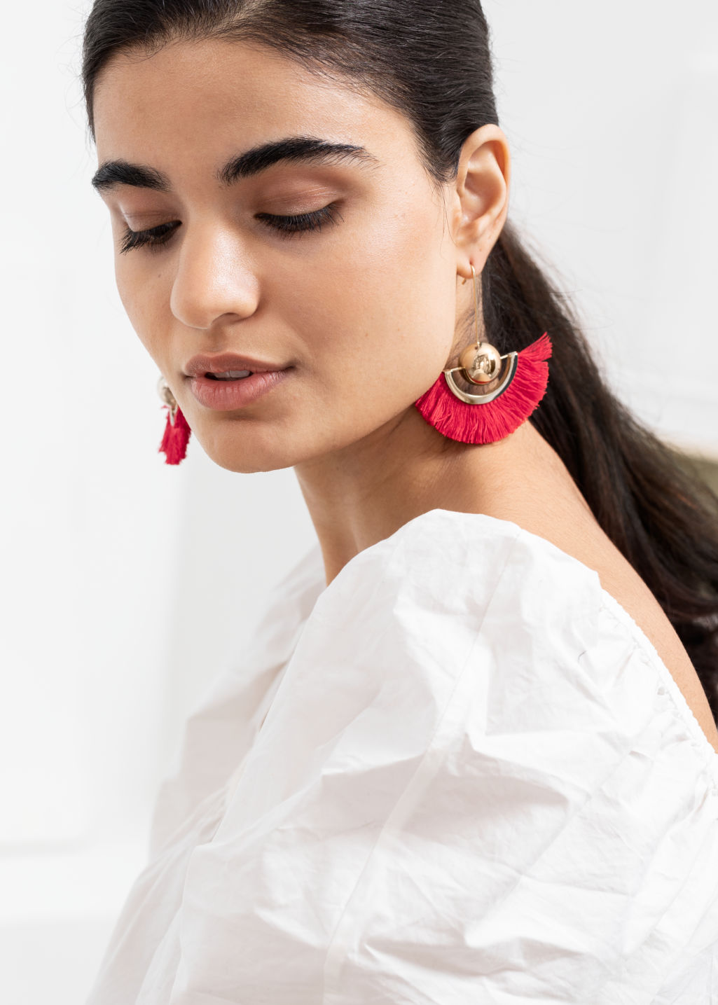 Back image of Stories pendant fringe earrings in red