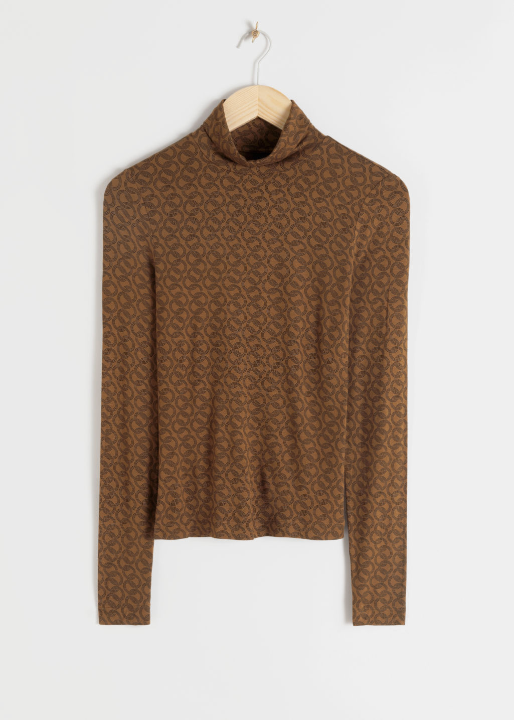Front image of Stories fitted stretch turtleneck top in beige