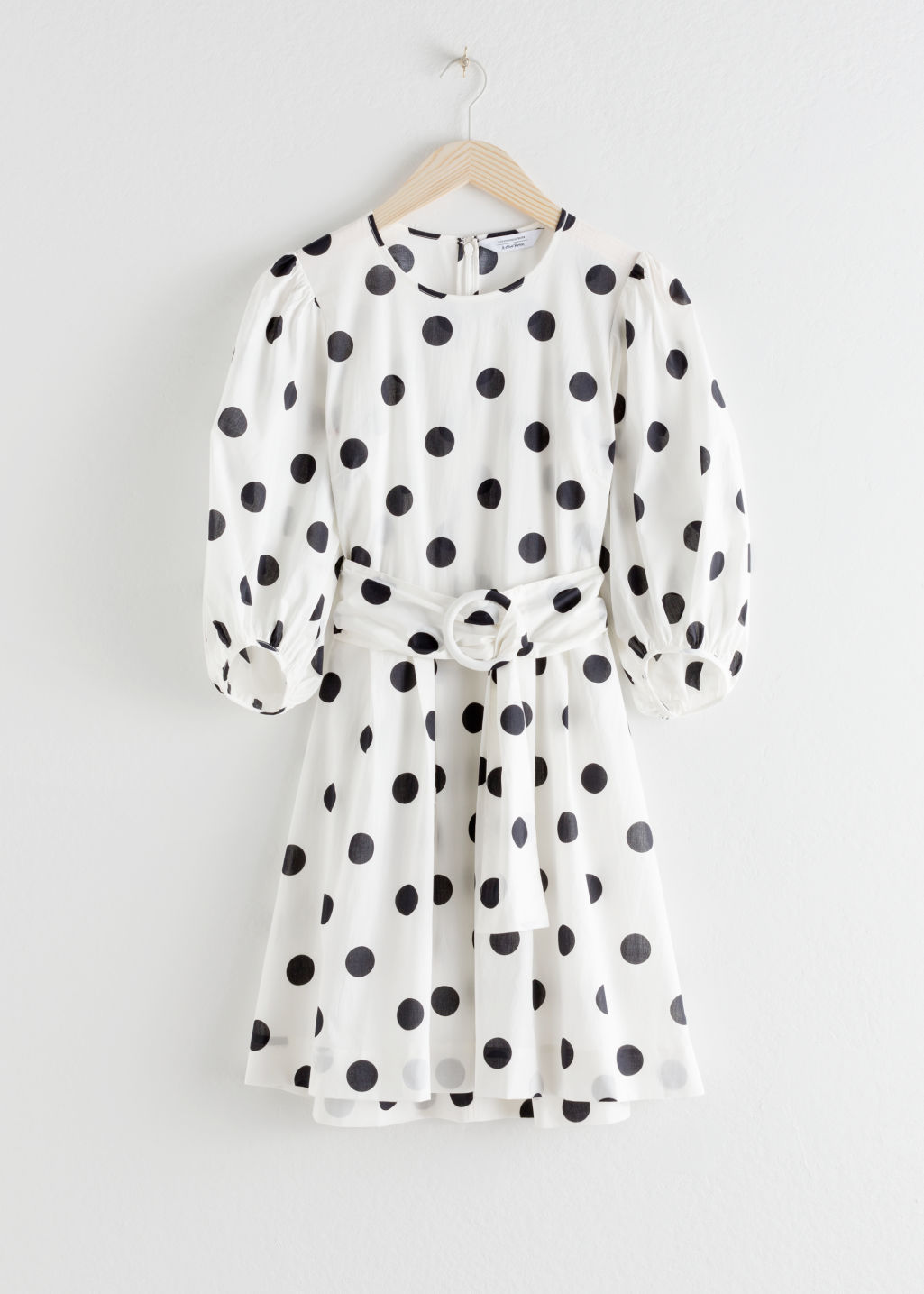 StillLife Front Image of Stories Belted Polka Dot Mini Dress in Black