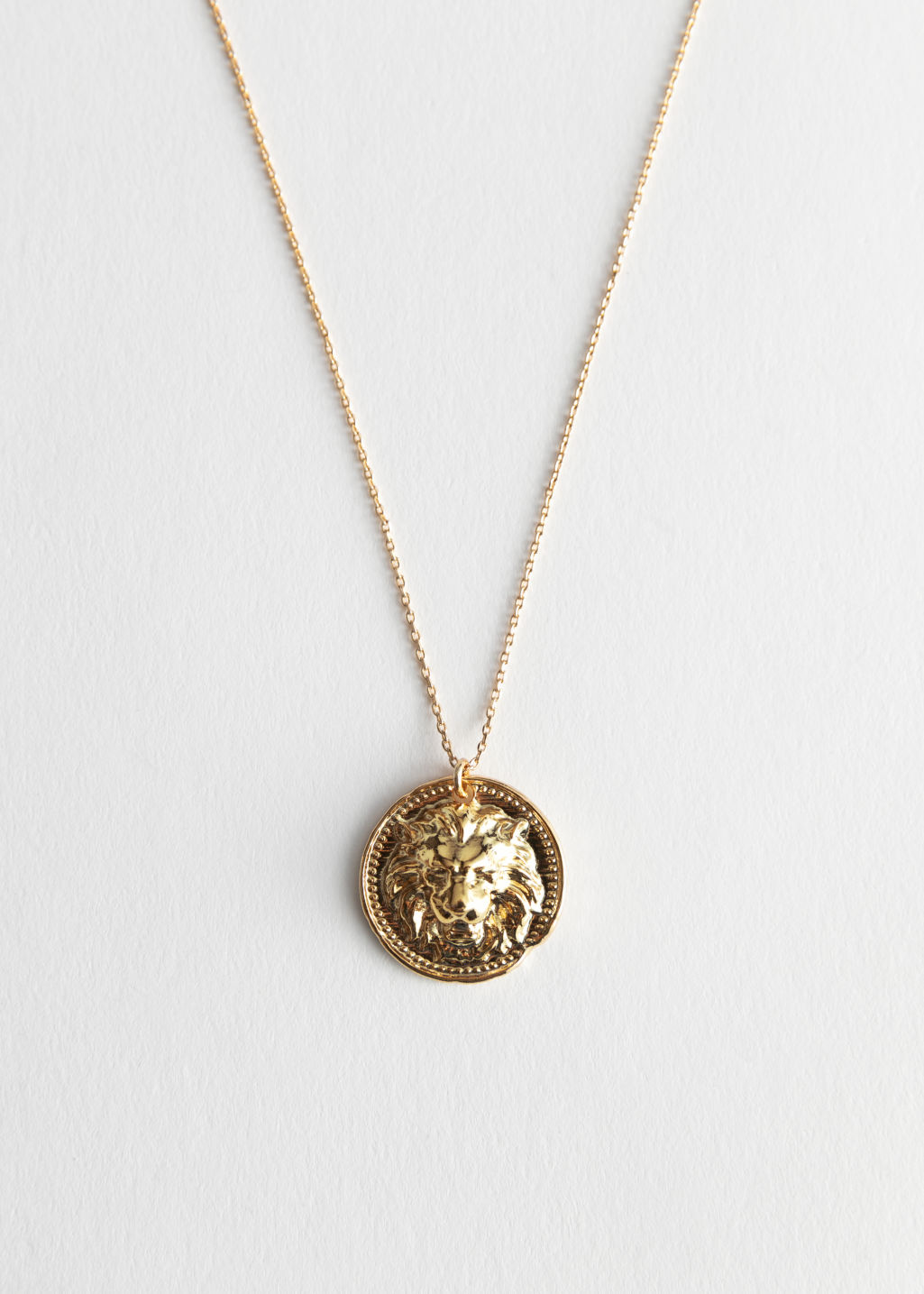 Front image of Stories lion head pendant necklace in gold