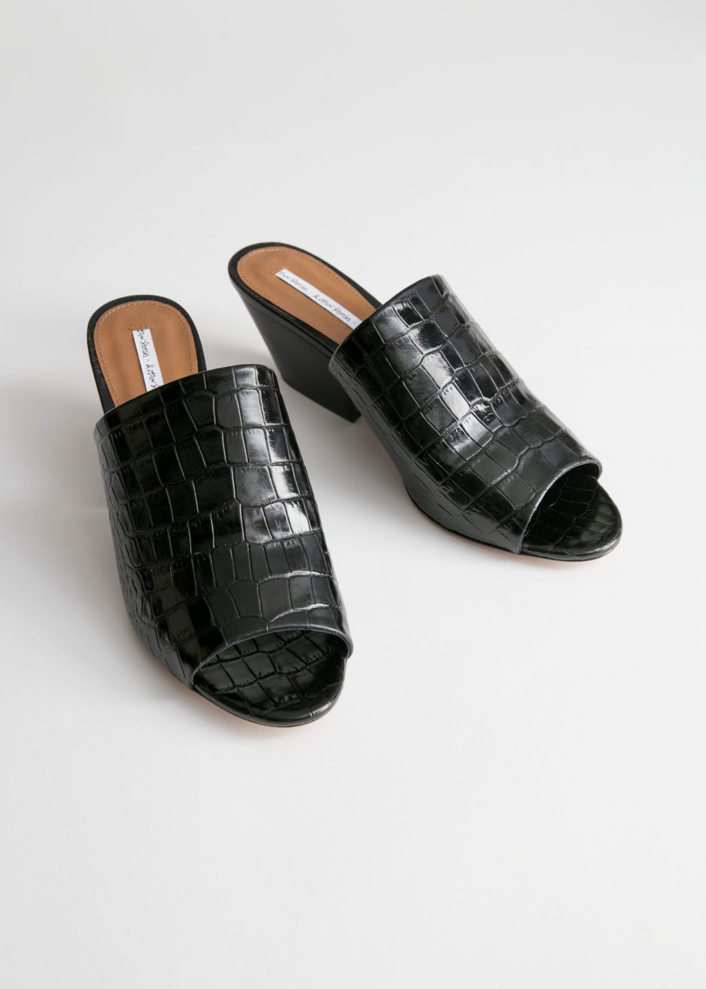 Back image of Stories open toe patent croc mules in black
