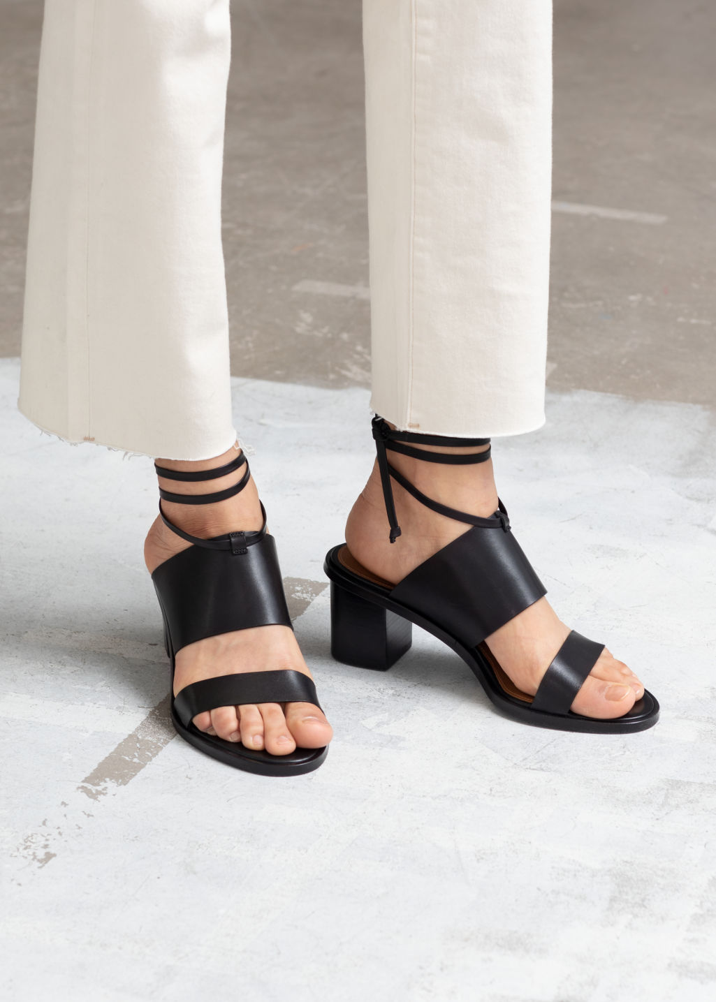 Front image of Stories lace up leather mule sandals in black