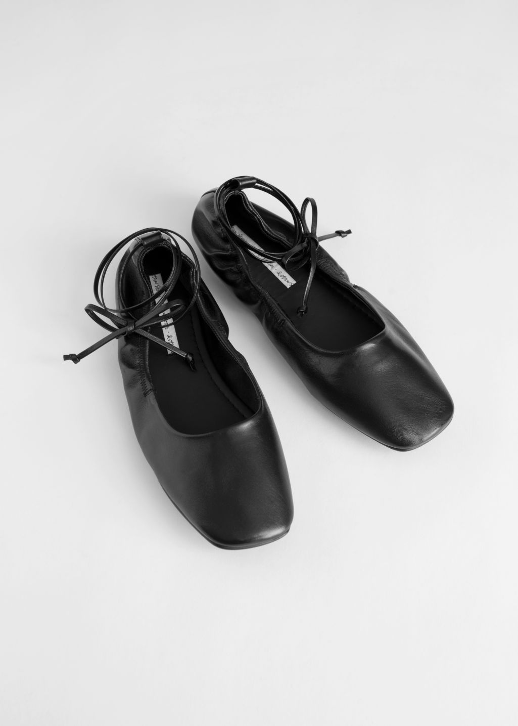 Front image of Stories square toe leather lace up flats in black