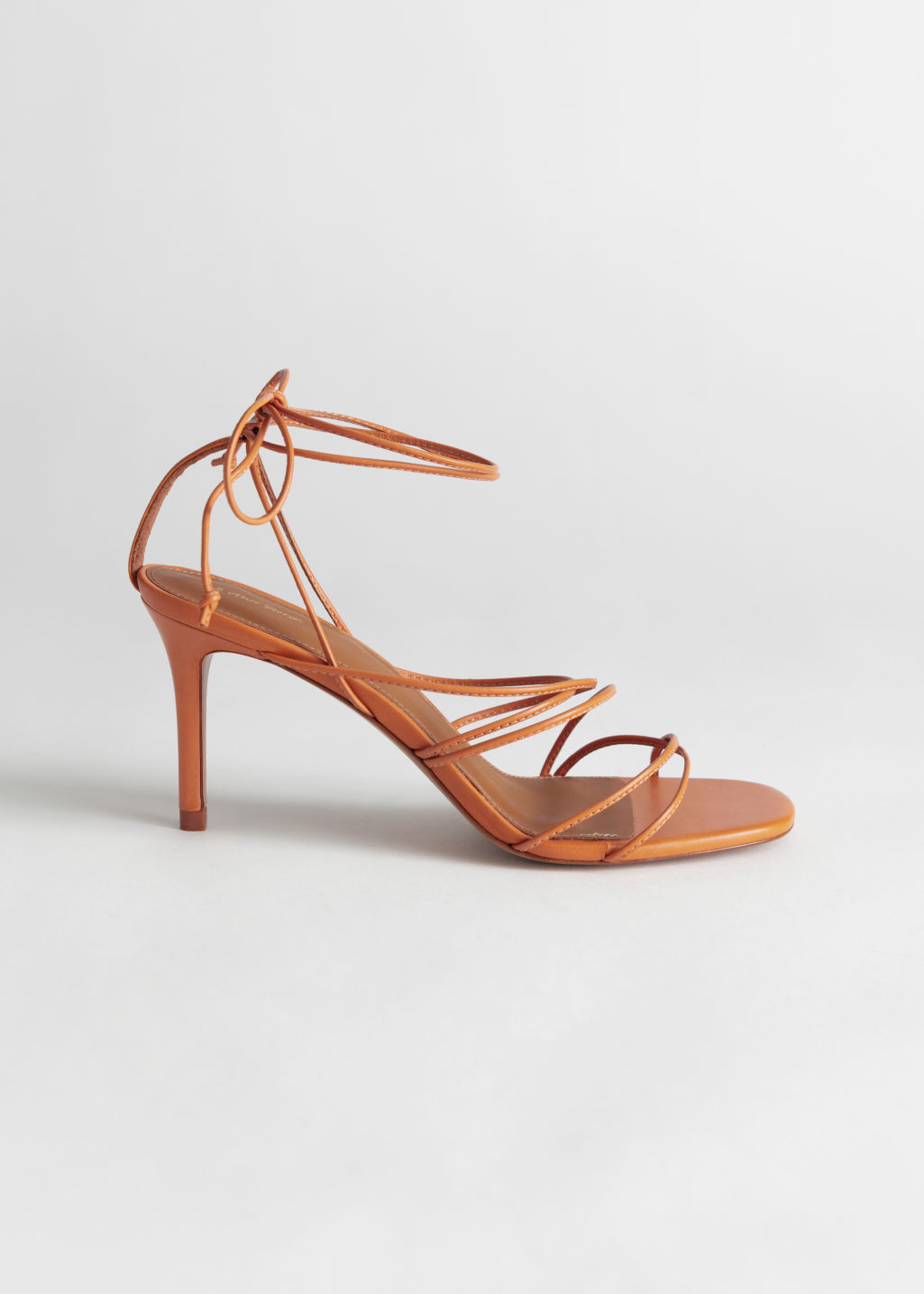 StillLife Front Image of Stories Strappy Lace Up Leather Stilettos in Orange