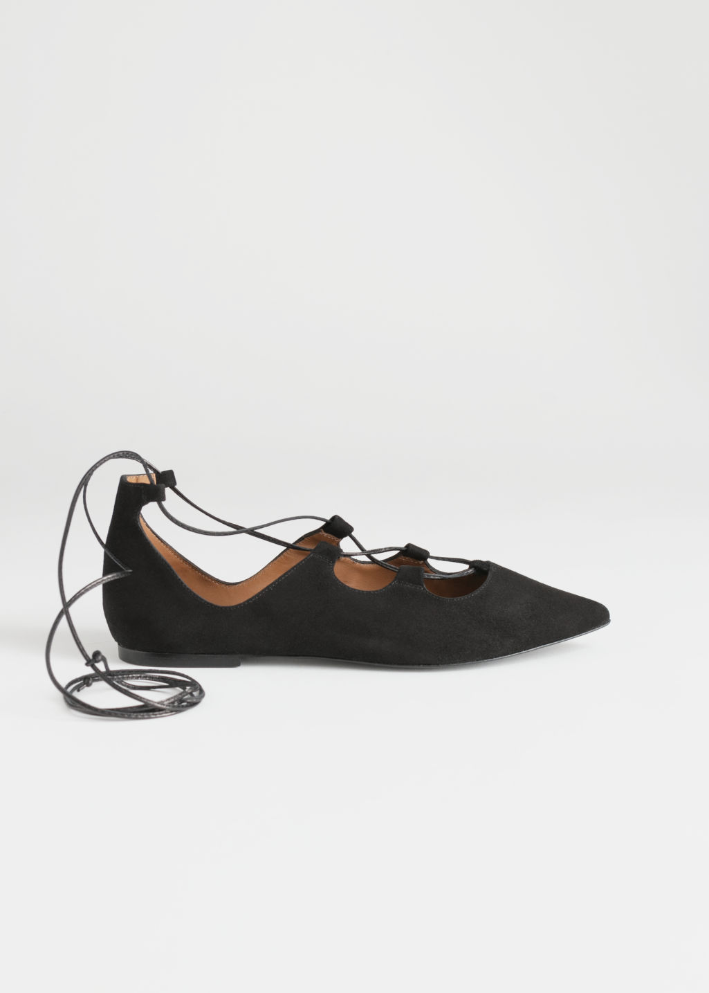 Front image of Stories pointed lace up suede flats in black