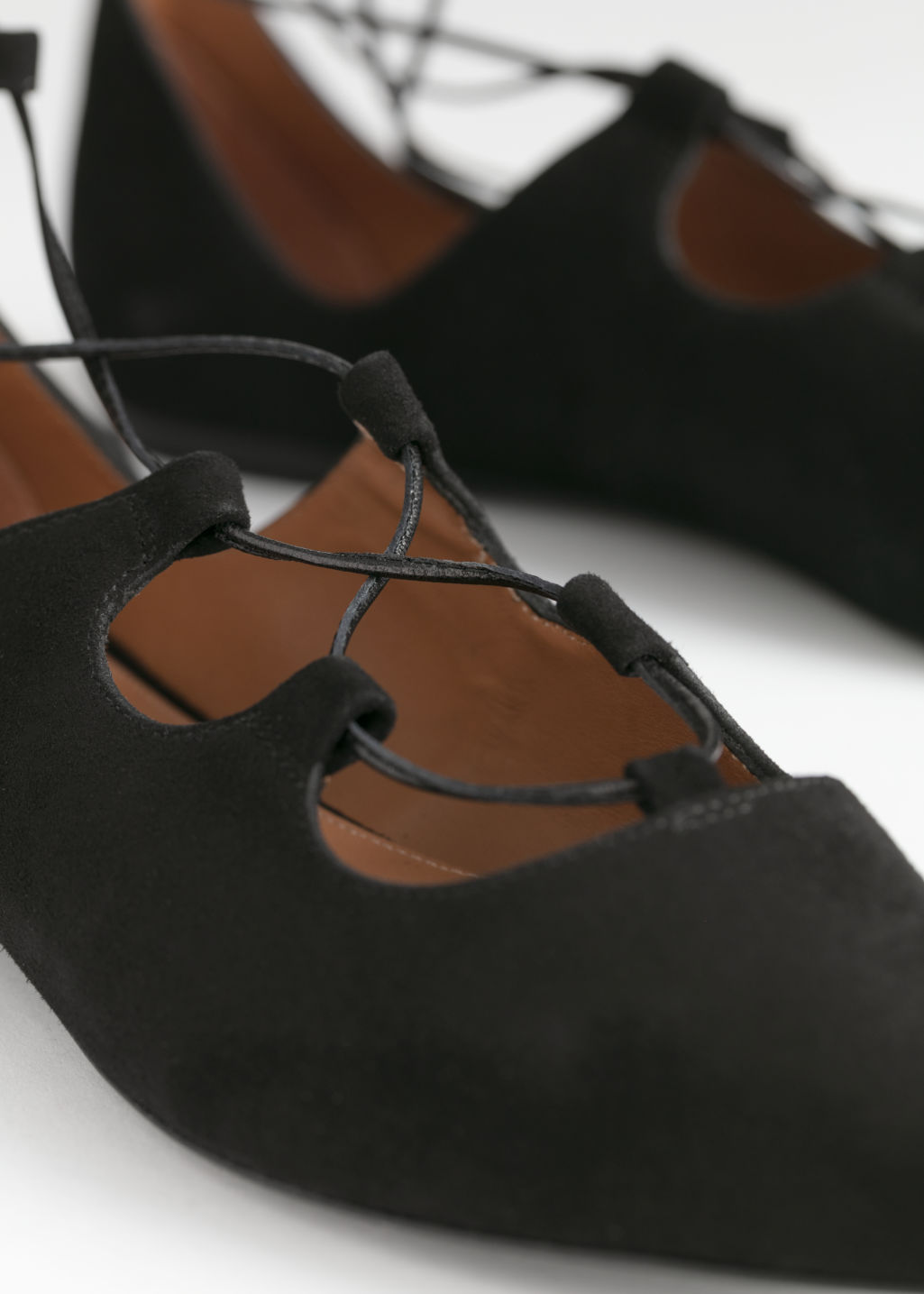 Back image of Stories pointed lace up suede flats in black