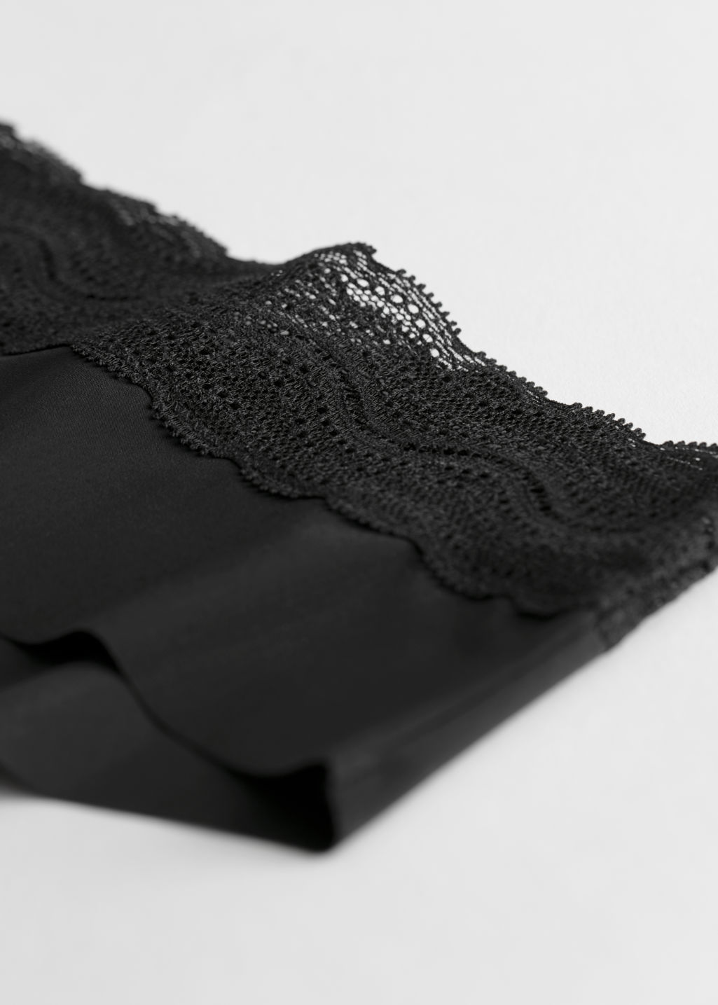 Back image of Stories squiggle lace hipster briefs in black