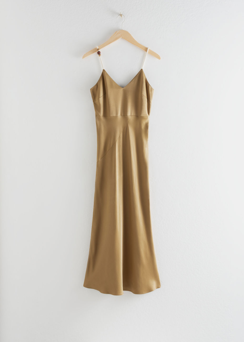 Front image of Stories rope strap midi slip dress in beige