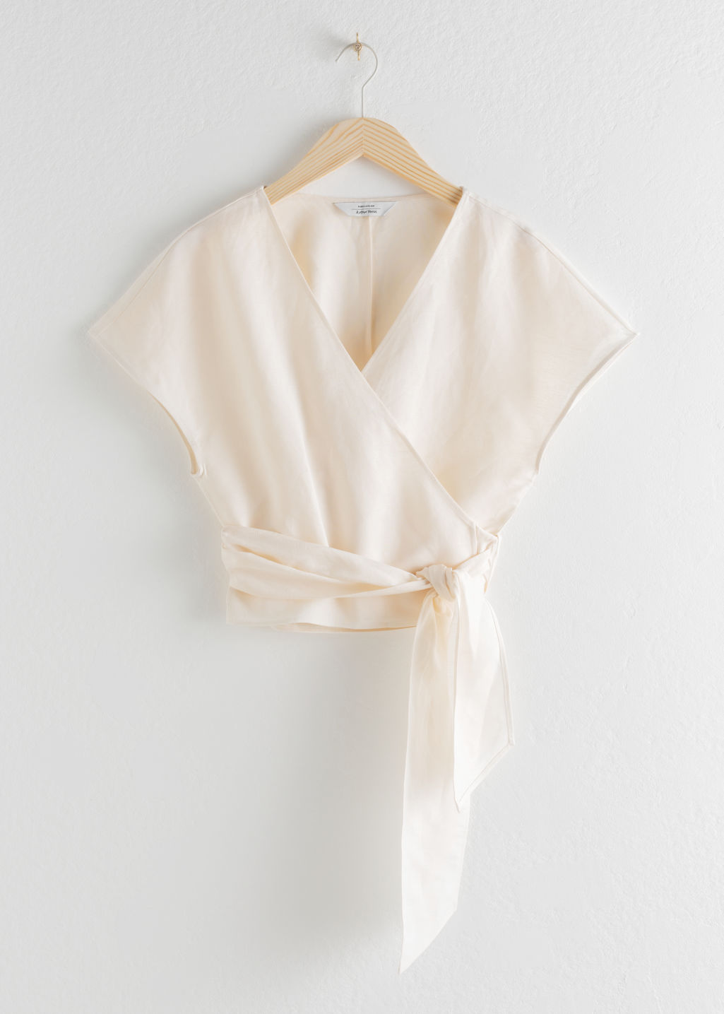 Front image of Stories linen blend wrap top in white