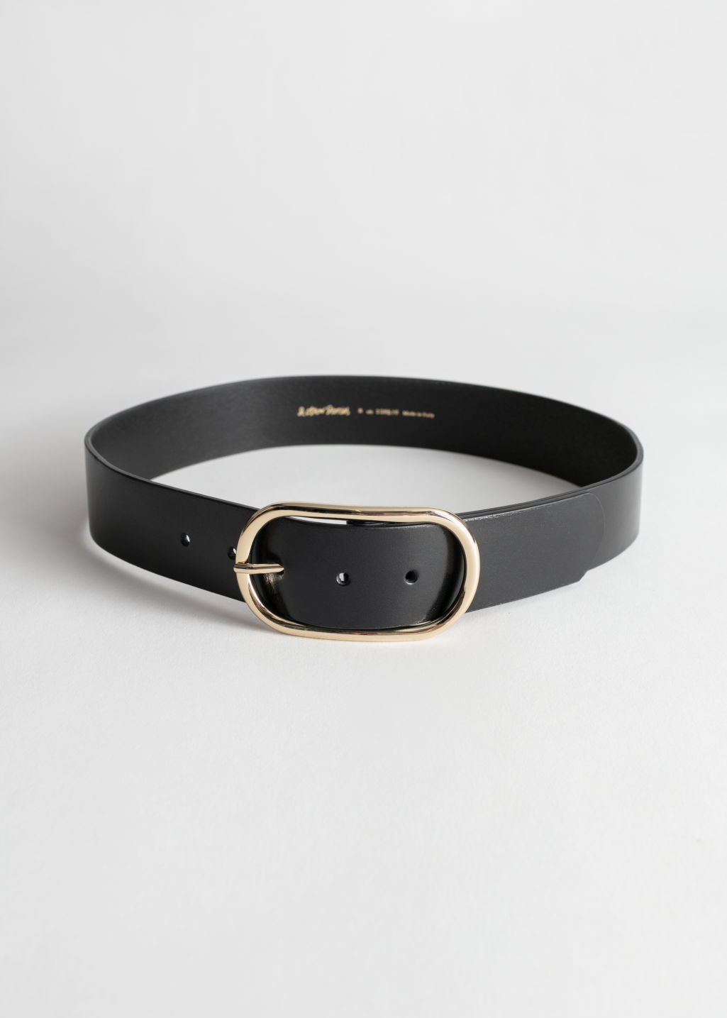 Front image of Stories oval buckle snake leather belt in black