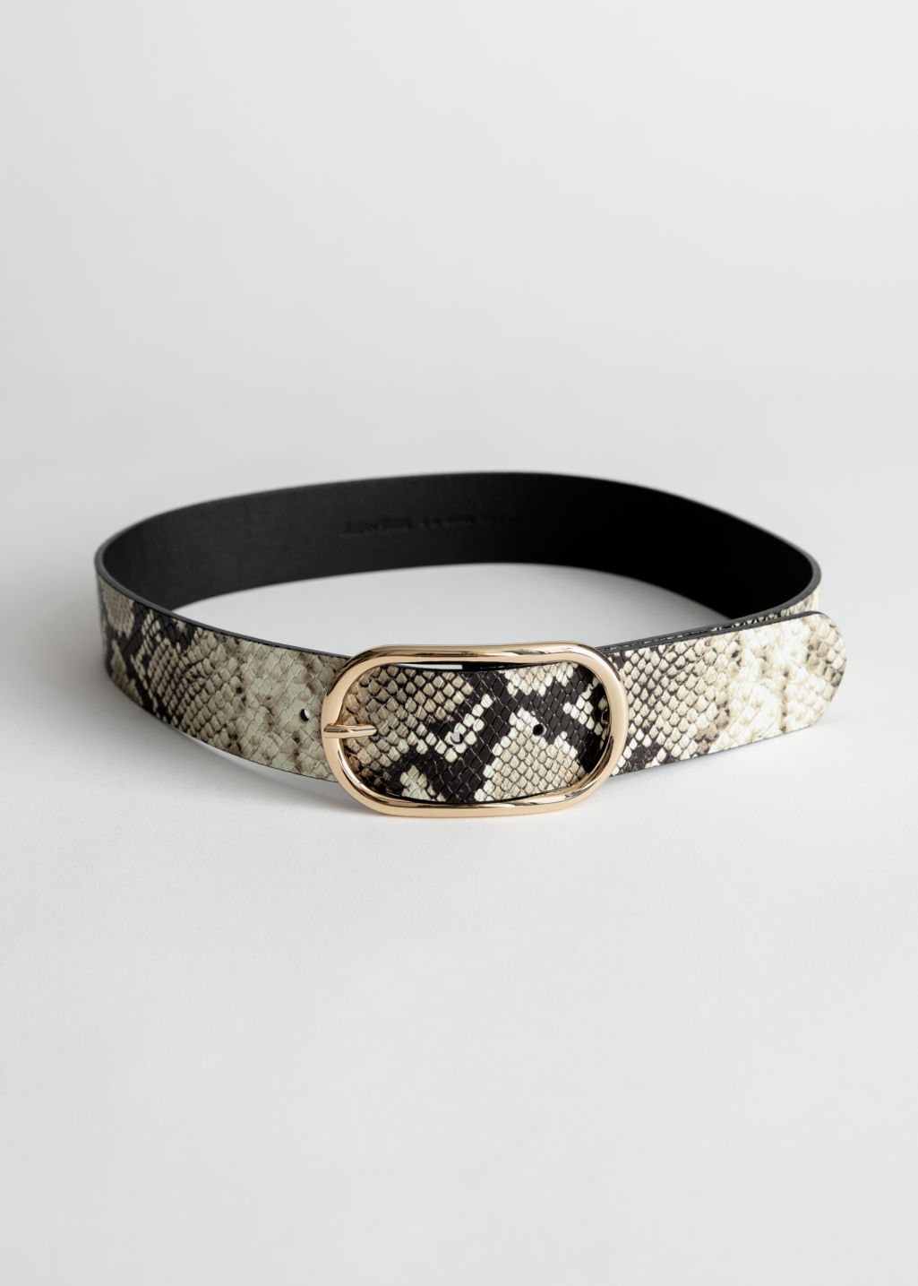 Front image of Stories oval buckle snake leather belt in beige