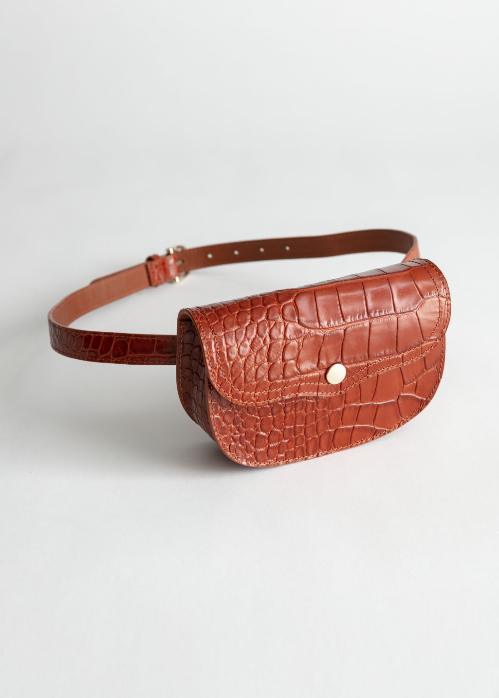 Front image of Stories structured leather croc beltbag in orange