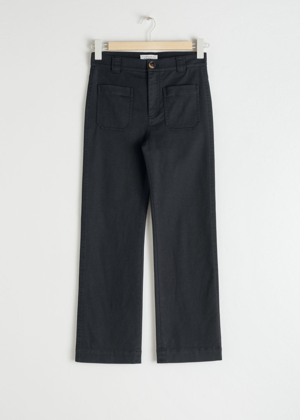 Front image of Stories cotton twill blend trousers in black