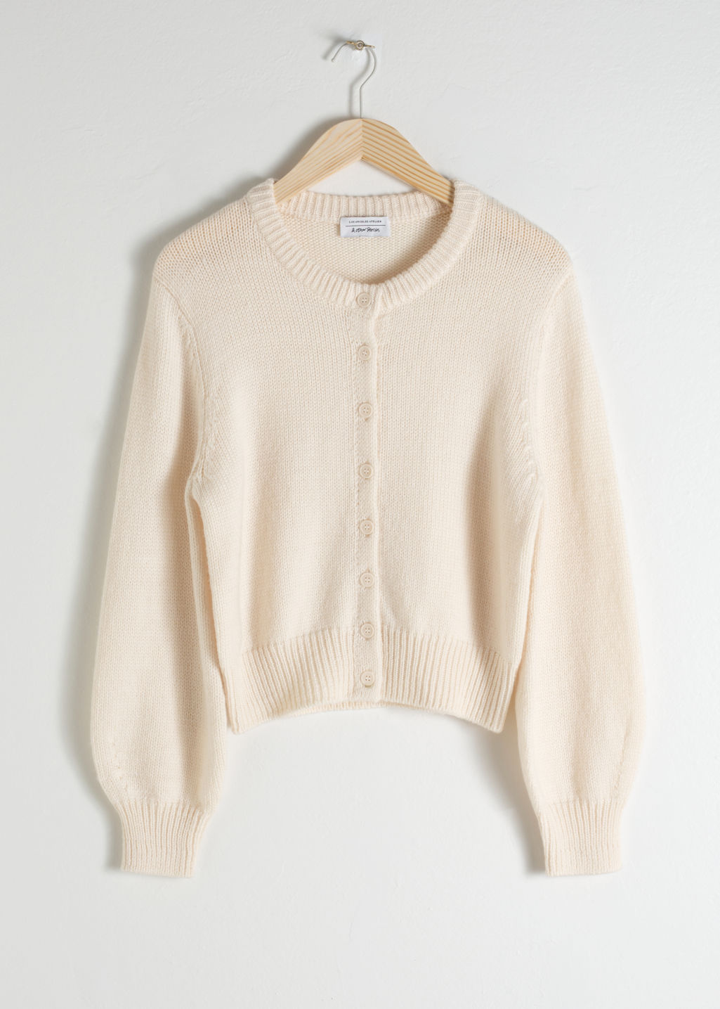 Front image of Stories cropped wool blend cardigan in white