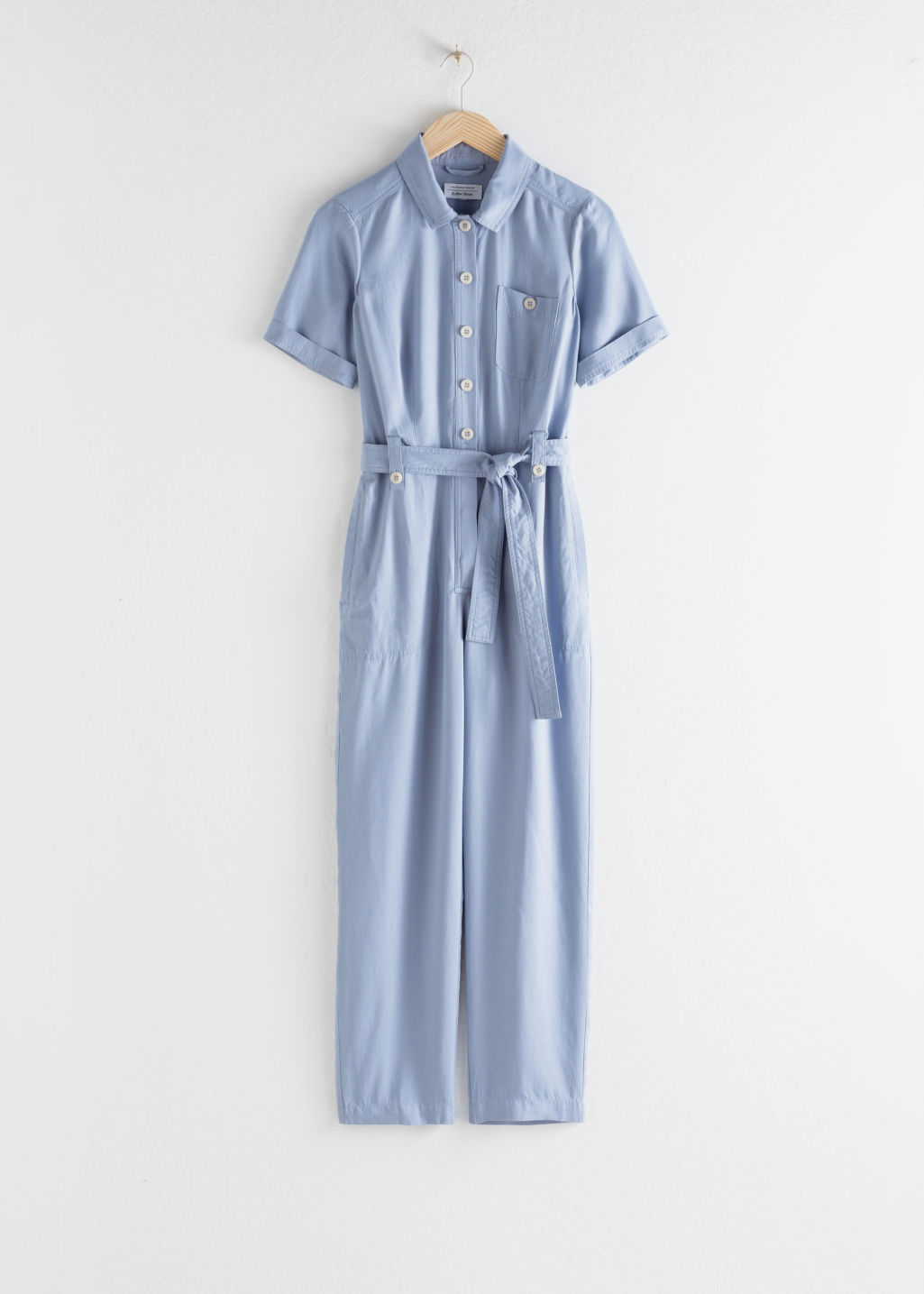 StillLife Front Image of Stories Belted Lyocell Jumpsuit in Blue